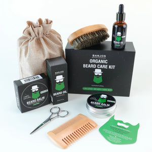beard care kit containing beard oils, beard balms, trimmers, brushes and a comb with black and green banjos beards labels