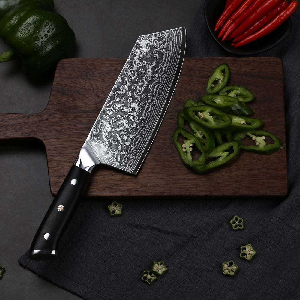 This large all-purpose kitchen knife will tackle a host of prep, from finely chopping herbs and nuts; preparing meat and hard veg like squash or red cabbage, as well as precision cutting vegetables. They come in a range of sizes (anything from a 15 to 36cm blade), so make sure you buy one that you feel comfortable using – not everyone likes a large knife. The handle should fit in your hand easily and feel well balanced. Spend a bit of money on this one, as it will last for years.