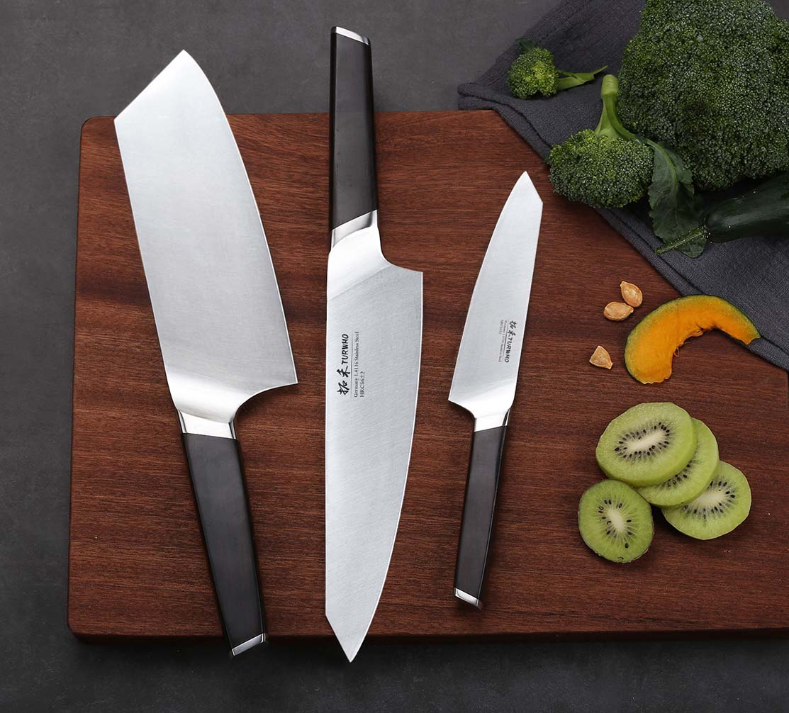 """Santoku knife - Typically smaller than a  Gyuto and more versatile. Roughly translated as """"three uses"""" relating to its three main uses; slicing, dicing and mincing. You don't use it with a rocking action Instead it's more of a chopping/slicing motion. Many Western cooks (including me) are now replacing there traditional Chef knives with a Santoku."""