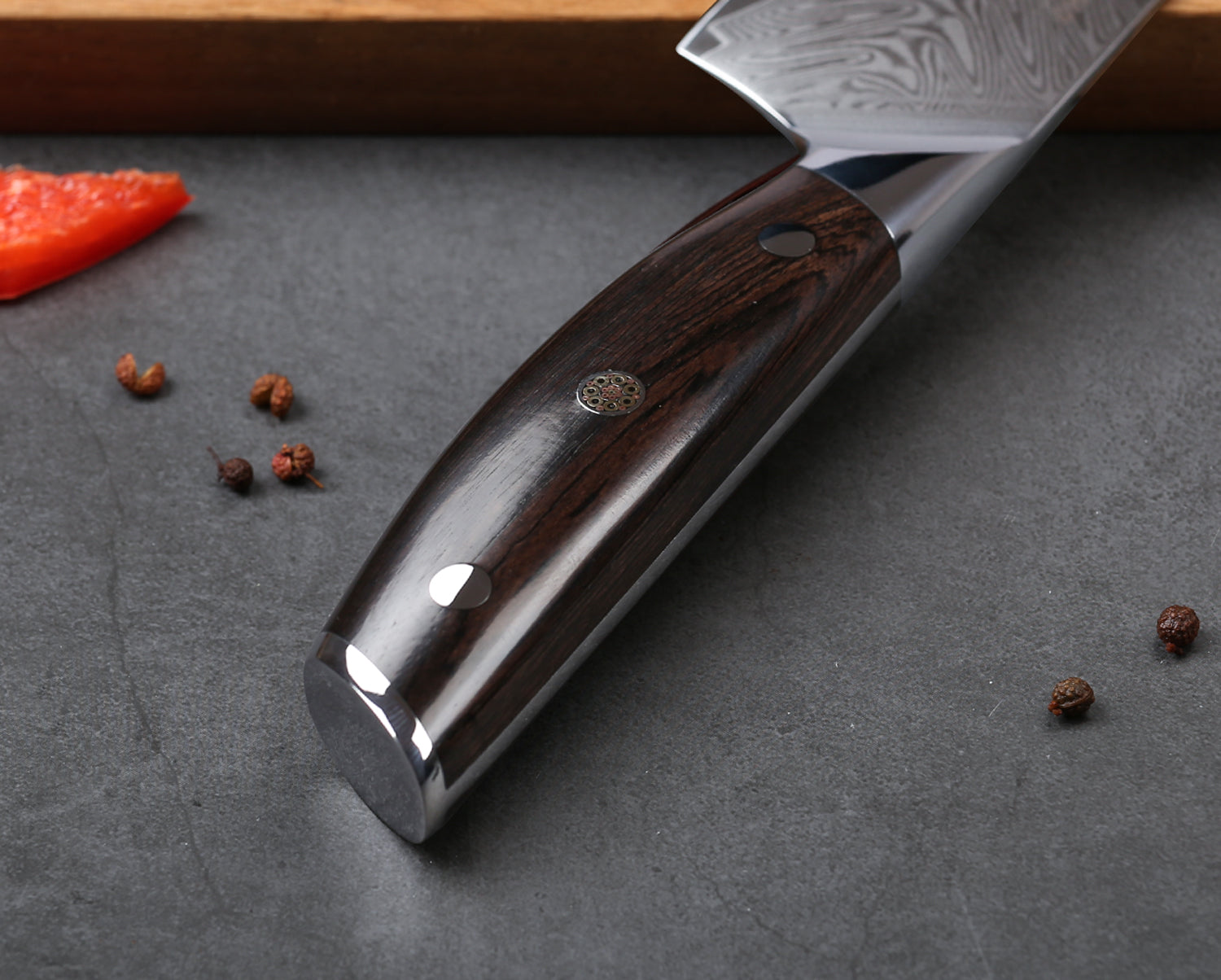 """Those scalloped granton edges add air between the knife blade and the material being cut, making it easier to remove the material from the blade. So, if you were slicing something thinly, you'd want to use this knife. Also, the word """"santoku"""" means """"three virtues"""" and applies to this knife due to its triad of abilities – chopping, dicing, and mincing. This is a very good general all-purpose knife to use for many jobs."""