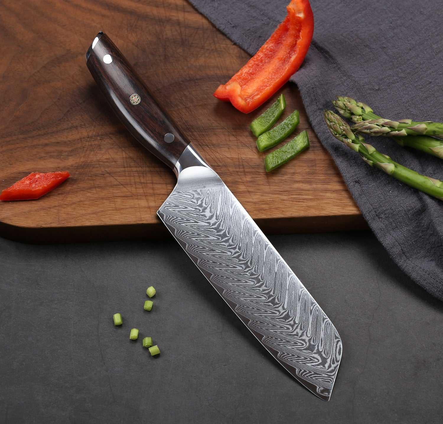 Incredibly razor sharp, full-tang, imported high-carbon German steel with a hand polished edge at 14-16 degrees per side. Oval shaped hollow divots minimize suction of stuck on food, slice faster and cleaner.
