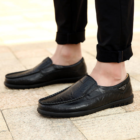 man with slip on leather mocassins