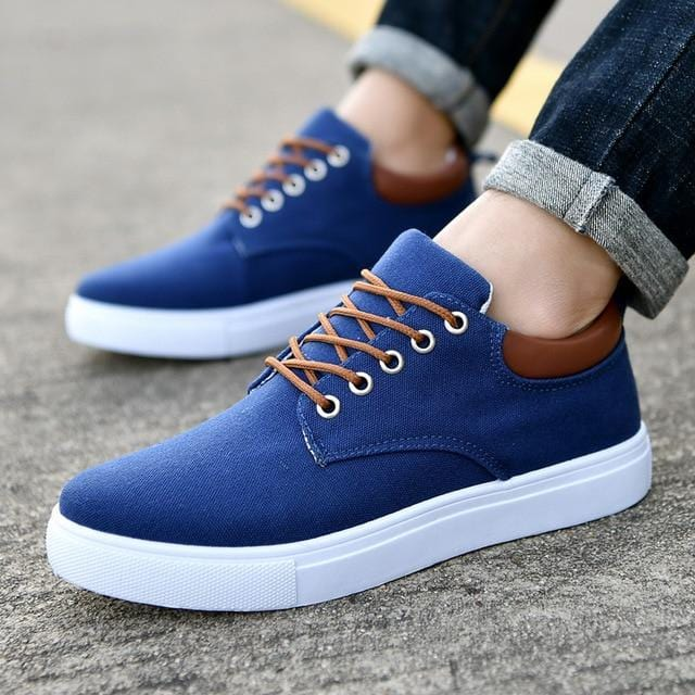 guy with pinroll jeans with canvas shoes with rubber sole