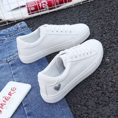 white sneaker with silver heart shoes for women
