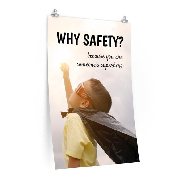A workplace safety poster showing a young child with a makeshift cape and mask striking a superhero pose with the slogan why safety? because you are someone's superhero.