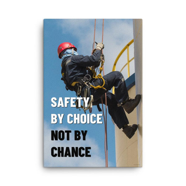 A fully harnessed man wearing a hard hat scaling the side of a building with a bright blue sky and clouds in the background with the text safety by choice, not by chance in bold text to his left.-Canvas-24×36