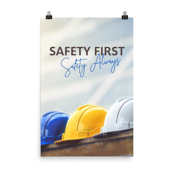 A workplace safety poster showing a white, a yellow, and a blue hardhat sitting on a wall with the slogan safety first, safety always.