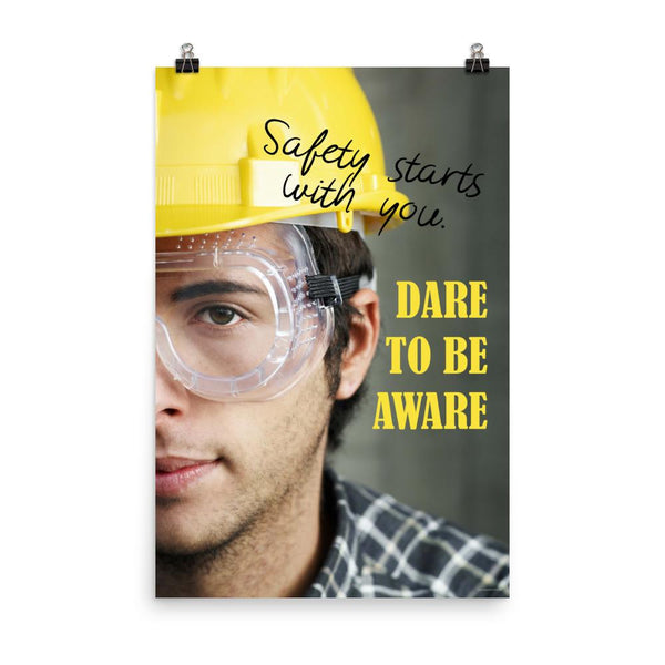 Safety poster showing a close up on half of a man's face wearing a yellow hard hat and safety glasses with text to the right.