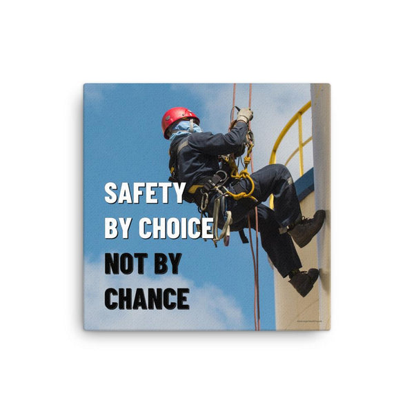 A fully harnessed man wearing a hard hat scaling the side of a building with a bright blue sky and clouds in the background with the text safety by choice, not by chance in bold text to his left.-Canvas-16×16