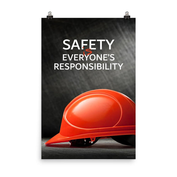 A workplace safety poster showing a red hard hat in front of a grey, industrial-looking background with the slogan safety is everyone's responsibility.
