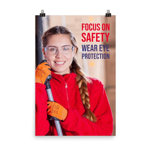 An eye safety poster of a young woman wearing safety glasses and orange gloves smiling as she works in a warehouse with a safety slogan in the top right corner.