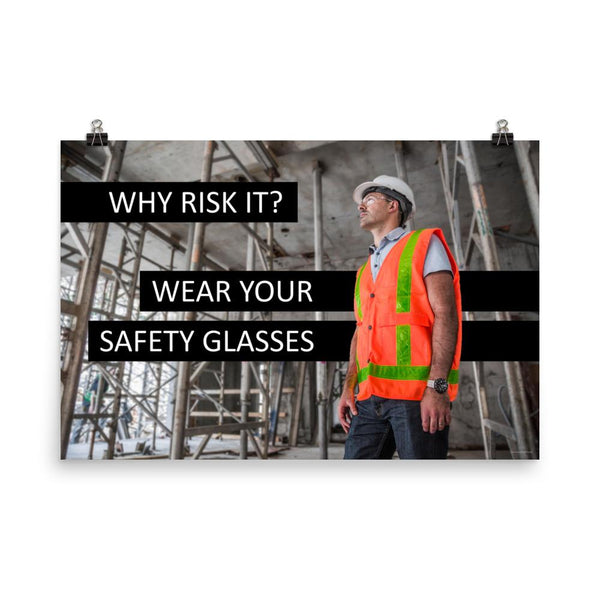 A safety poster showing a construction worker in a reflective orange vest, hard hat, and safety glasses on a construction site looking out with a safety slogan to the left.