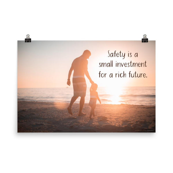 A workplace safety poster showing a father and his young daughter walking on the shore of a beach with a beautiful sunset in the background and text saying safety is a small investment for a rich future.