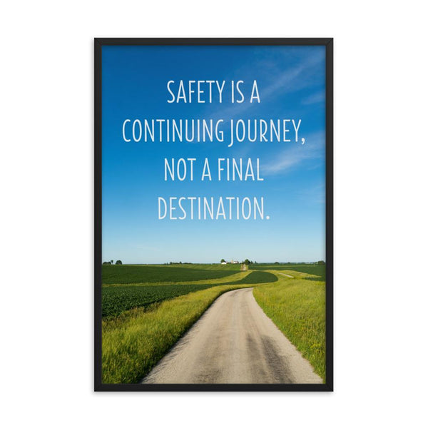 A workplace safety poster depicting a beautiful sunny day with a bright blue sky and a lush green field being cut down the middle by a dirt road leading off into the countryside with the text safety is a continuing journey, not a final destination.