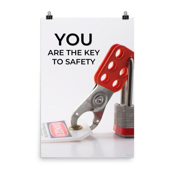 A workplace safety poster showing a lockout tagout lock and tag with the text you are the key to safety.