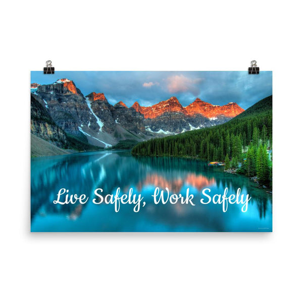 A workplace safety poster depicting a beautiful landscape of mountains with a river flowing down the side of the mountains into a bright blue pond with text saying live safely work safely.