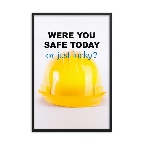 A workplace safety poster showing a yellow hard hat on a plain white background with the slogan were you safe today, or just lucky?