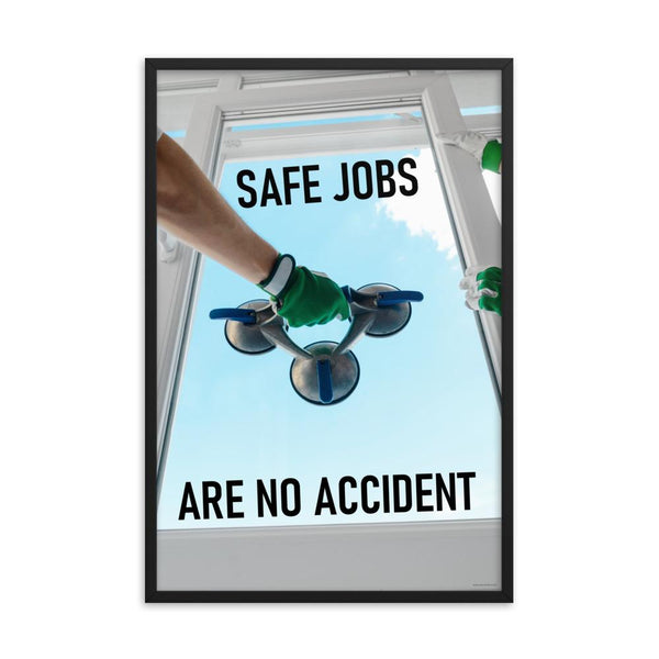 A workplace safety poster showing a close-up of two worker's hands wearing gloves while installing windows with the slogan safe jobs are no accident.