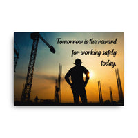 A safety poster showing a worker on a construction site being silhouetted by a sunset of orange and blue colors with the slogan tomorrow is the reward for working safely today.