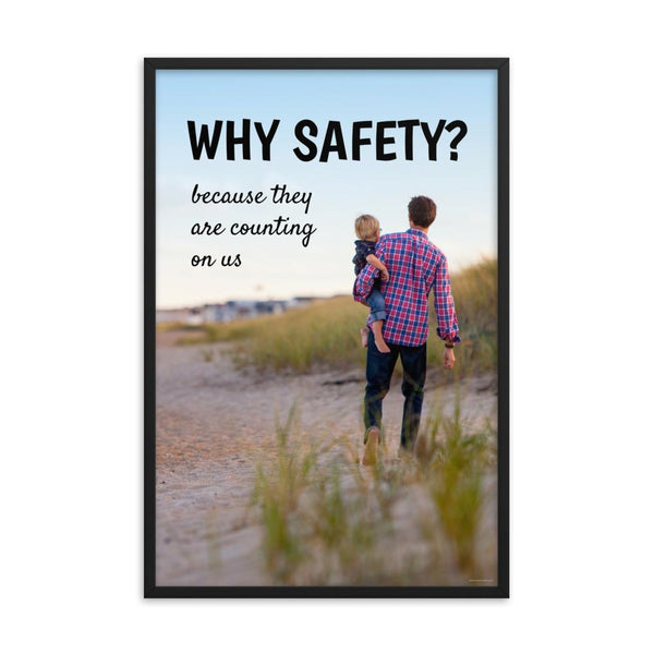 A workplace safety poster showing a man carrying his young child along the beach on a beautiful sunny day with the slogan why safety? because they are counting on us.