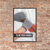A workplace safety poster showing a close-up of a worker's hands wearing gloves while installing windows with the slogan safety is in your hands.