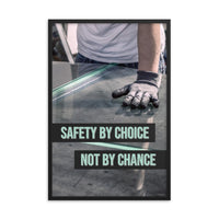 A workplace safety poster showing a close-up of a worker's hands grabbing panes of glass with gloves on with the slogan safety by choice not by chance.