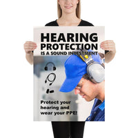 An ear safety poster showing a close up of a man's profile wearing ear muffs and safety glasses with a safety slogan and infographics of hearing PPE all around him.