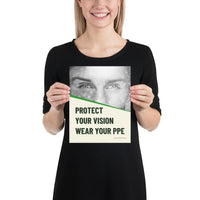 An eye safety poster of a black and white close up of a man's eyes looking intently forward with a safety slogan in blue text below.