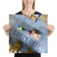 A safety poster showing a bird's-eye view of a worker in a warehouse pulling boxes on a pallet jack with the slogan safety first in bold letters.