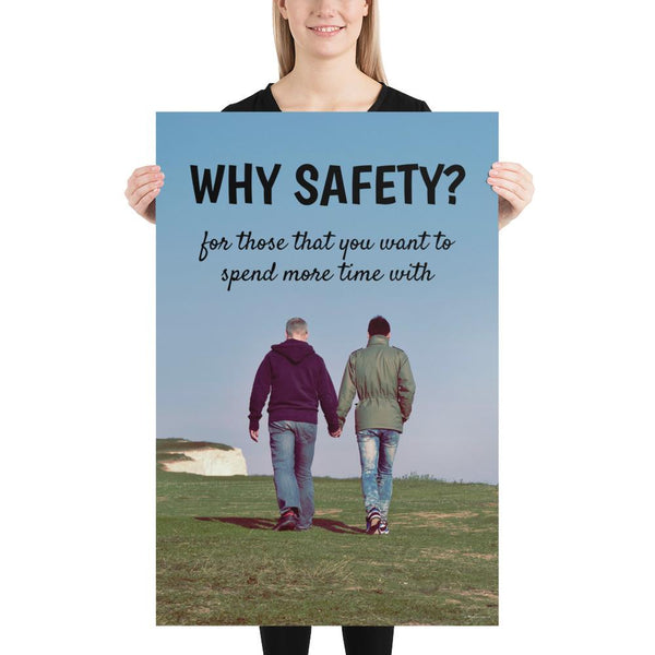 A workplace safety poster showing a couple holding hands and strolling happily along a grassy hill with a bright blue sky in the background with the slogan why safety? for those that you want to spend more time with.