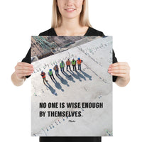 A workplace safety poster showing an aerial view of construction workers in reflective vests standing in a line on top of a building with their shadows being cast on the building with the quote no one is wise enough by themselves by Plautus.