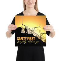 A workplace safety poster showing a construction site and construction workers being silhouetted by a bright and beautiful sunset of different shades of orange with the slogan safety first, safety always.
