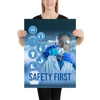 A safety poster showing a lab worker in a white coat and safety glasses conducting an experiment with infographic icons of PPE to the side and the slogan safety first.