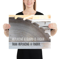 A workplace safety poster depicting a close up of a table saw blade in a workshop with a safety slogan on the bottom half of poster.