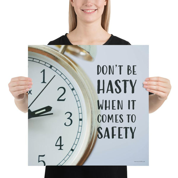 A workplace safety poster showing a close-up of a clock face with the slogan don't be hasty when it comes to safety.