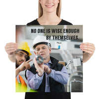 A workplace safety poster showing two workers in hardhats, reflective vests, and safety glasses collaborating together in a factory with the quote no one is wise enough by themselves by Plautus.