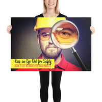 A workplace safety poster showing a portrait of a man wearing a hardhat and safety glasses with a magnifying glass magnifying one eye with the slogan, keep an eye out for safety, don't get blinded by bad habits.