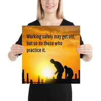 A workplace safety poster showing a construction site and construction workers being silhouetted by a bright and beautiful sunset of different shades of orange with the slogan working safely may get old, but so do those who practice it.