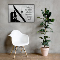 A workplace safety poster showing a construction ironworker working on a construction site with everything silhouetted black with a light grey background and with the slogan safety is the mirror reflecting the quality of your work.