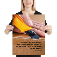 A workplace safety poster showing a close-up of hands opening a box using a boxcutter with a safety quote below the hands.