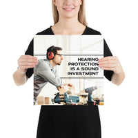 A workplace safety poster of a man in safety glasses and earmuffs taking a break in his woodshop with a safety slogan to the right.