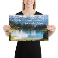 A workplace safety poster depicting a beautiful pond in the foreground, lush evergreens in the middle ground and snow-capped mountains in the background with text saying safety is a small investment for a rich future.