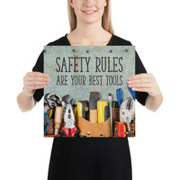 A safety poster showing various tools including screwdrivers, pliers, and wrenches laying on a worktable with the slogan safety rules are your best tools.