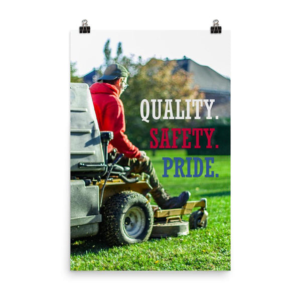 A workplace safety poster showing a man mowing a lawn on a sitting mower with the words quality, safety, pride in white, red, and blue, respectively.