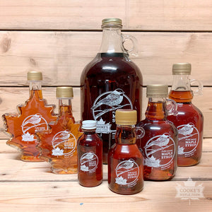 Cooke's Maple Farm Maine Maple Syrup family of glass bottle products.