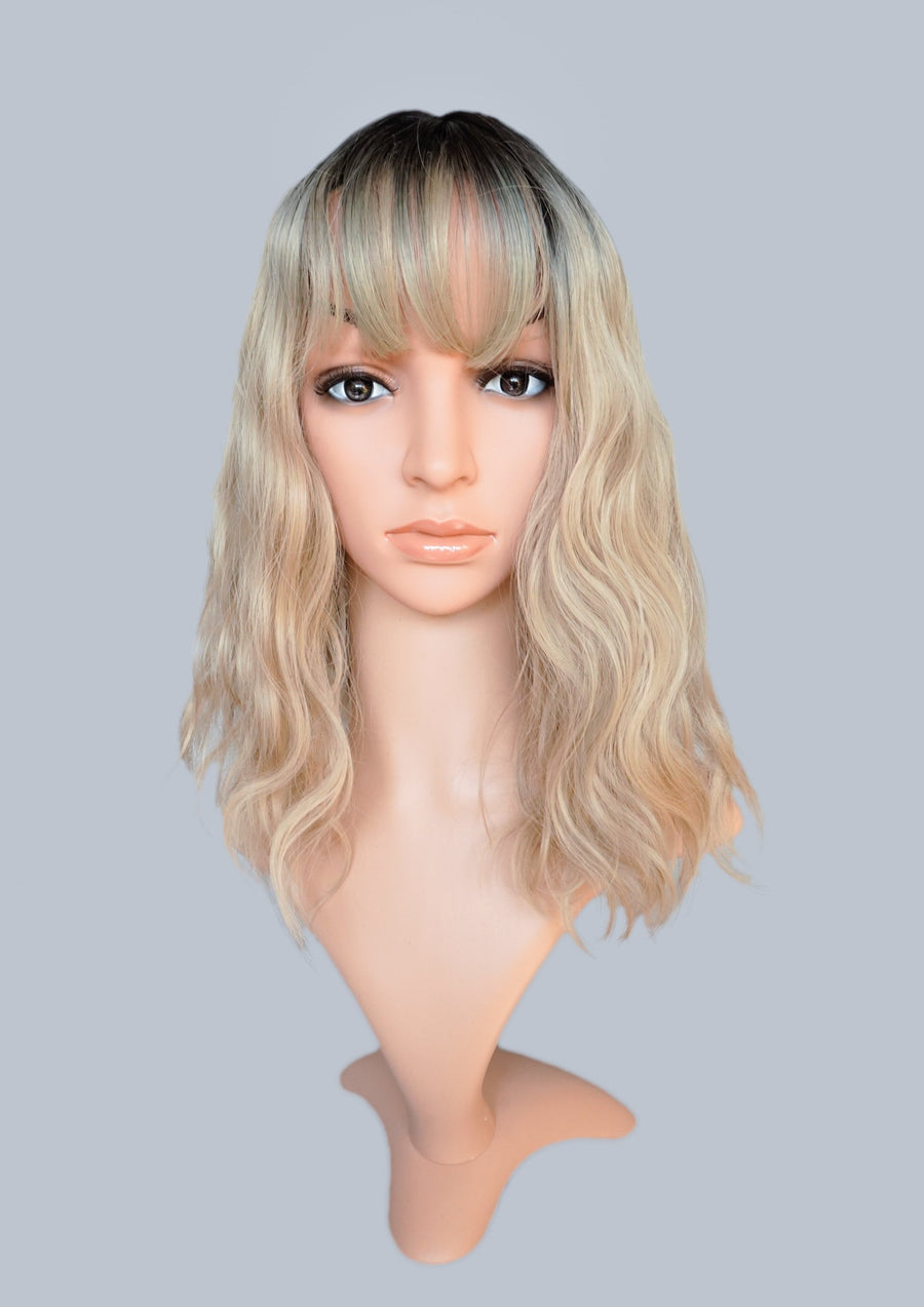 Wavy Blond Wig With Ombre Roots & Bangs