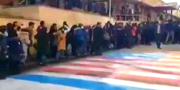 WATCH: Iranian protestors refuse to trample US/Israel flags
