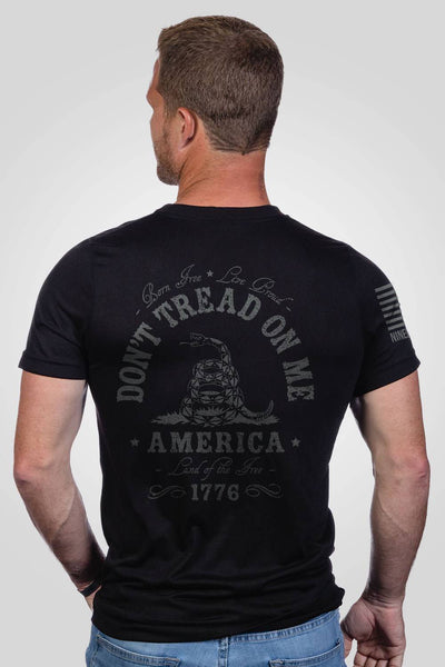 Black don't tread on me men's performance shirt, rear view