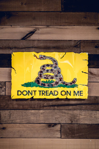 Yellow molten metal don't tread on me wall sign
