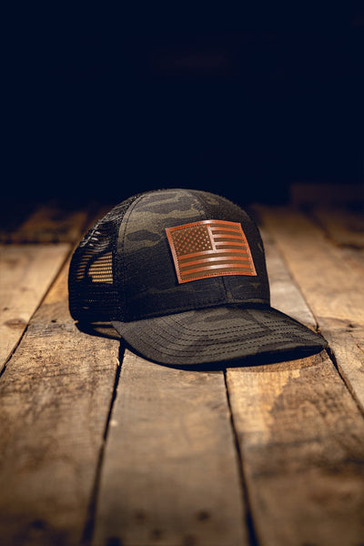Dark Multicam Trucker Hat with Leather Flag